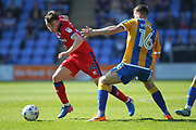 Ollie Rathbone wins a challenge during the EFL Sky Bet League 1 match between Shrewsbury Town and Rochdale at Greenhous Meadow, Shrewsbury, England on 8 April 2017. Photo by Daniel Youngs.