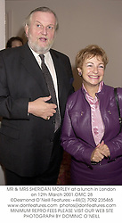 MR & MRS SHERIDAN MORLEY at a lunch in London on 12th March 2001.			OMC 28