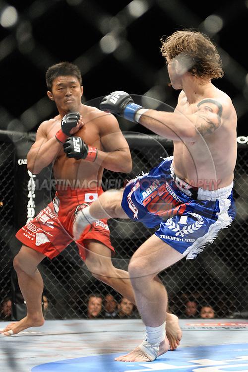"LAS VEGAS, NEVADA. JULY 11, 2009: Yoshihiro Akiyama and Alan Belcher during ""UFC 100: Making History"" inside the Mandalay Bay Events Center in Las Vegas, Nevada."