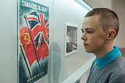 Comrades in arms - Pupils from Thomas Tallis School in Kidbrooke who are doing Russian studies, visit the exhibition - Tate Modern's new exhibition Red Star Over Russia on the 100th anniversary of the October Revolution. The exhibition offers a visual history of the Soviet Union, revealing how seismic political events inspired a wave of innovation in art and graphic design. Featuring over 250 posters, paintings and photographs, many on public display for the first time, the exhibition will provide a chance to understand how life and art were transformed during a defining period in modern world history.