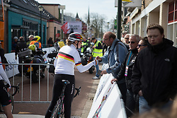 Mieke Kröger (GER) of CANYON//SRAM Racing signs an autograph before Stage 1b of the Healthy Ageing Tour - a 77.6 km road race, starting and finishing in Grijpskerk on April 5, 2017, in Groeningen, Netherlands.