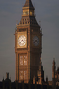 The Elizabeth Tower of the British Houses of Parliament, the seat of the UK's government, on 17th January 2017, in London England. The Elizabeth Tower (previously called the Clock Tower) named in tribute to Queen Elizabeth II in her Diamond Jubilee year – was raised as a part of Charles Barry's design for a new palace, after the old Palace of Westminster was largely destroyed by fire on the night of 16 October 1834. The new Parliament was built in a Neo-gothic style. Although Barry was the chief architect of the Palace, he turned to Augustus Pugin for the design of the clock tower. It celebrated its 150th anniversary on 31 May 2009. The tower was completed in 1858 and has become one of the most prominent symbols of both London and England.
