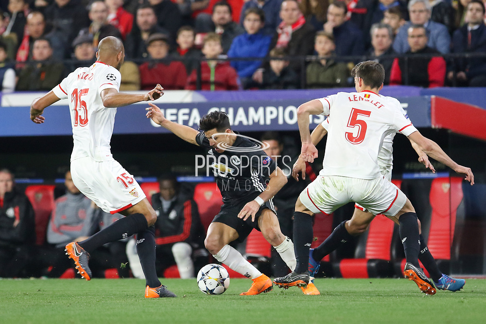 Manchester United Forward Alexis Sanchez battles with Sevilla midfielder Steven N'Zonzi (15) and Sevilla defender Clement Lenglet (5) during the Champions League match between Sevilla and Manchester United at the Ramon Sanchez Pizjuan Stadium, Seville, Spain on 21 February 2018. Picture by Phil Duncan.