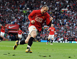 Wayne Rooney celebrates scoring the second goal for Manchester United during the Premier League match between Manchester United and Tottenham Hotspur at Old Trafford, Manchester, England, 25th April 2009