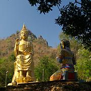A Buddha statue at Wat Khao Tham Talu in Ratchaburi province, Thailand