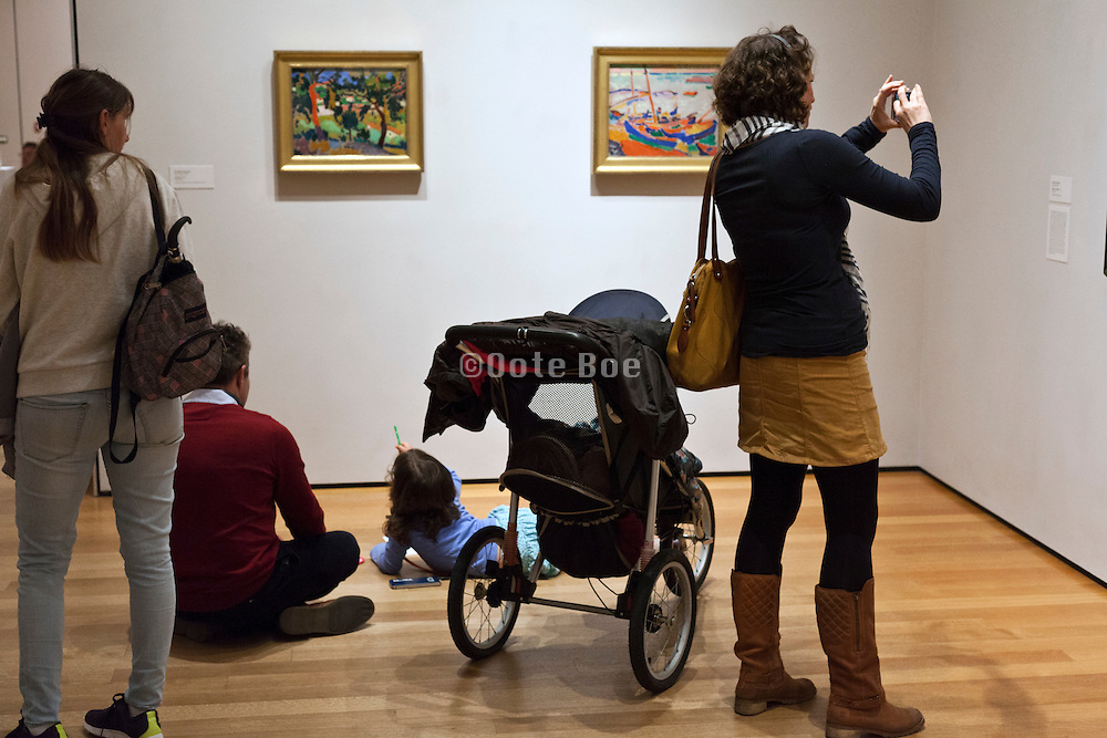 father with child studying and drawing art at the Museum of modern art in New York