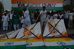 August 16, 2017 - Lahore, Punjab, Pakistan - Pakistani members of Youth Forum for Kashmir burn Indian national flag and Indian prime minister Narendra Modi's portrait during demonstration against Indian atrocities in Kashmir in Lahore. Kashmiris on both sides of the line of control and across the world would be observing the Indian Independence Day on August 15 as a black day to convey the message to the international community that India has usurped their inalienable right to self-determination. Protest rallies are to be held in the territory and in the world capitals to highlight different dimensions of the Kashmir dispute and Indian atrocities against the innocent Kashmiris. (Credit Image: © Rana Sajid Hussain/Pacific Press via ZUMA Wire)