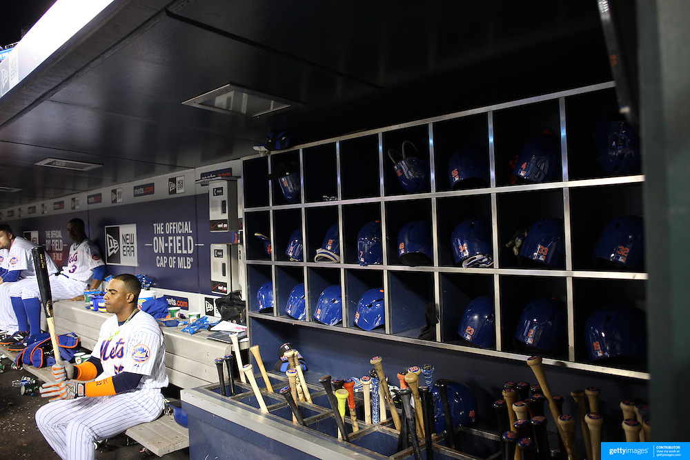 Yoenis Cespedes, New York Mets, preparing to bat in the dugout during the New York Mets Vs Atlanta Braves MLB regular season baseball game at Citi Field, Queens, New York. USA. 22nd September 2015. Photo Tim Clayton