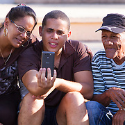 In Matanzas the WiFi hot spot is the Plaza de la Libertad. Cubans gather with their computer laptops or smart phones at night in Wi-Fi hot spots, mostly in neighborhood parks where locals congregate to surf the internet, make face time calls or check their out FaceBook and email accounts. <br /> Photography by Jose More