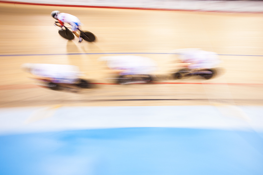 The Chilean team races in the 1st round race in the men's cycling team pursuit  at the 2015 Pan American Games in Toronto, Canada, July 18,  2015.  AFP PHOTO/GEOFF ROBINS