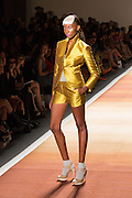 Shiny yellow satin shorts and matching jacket with a turned-up collar.