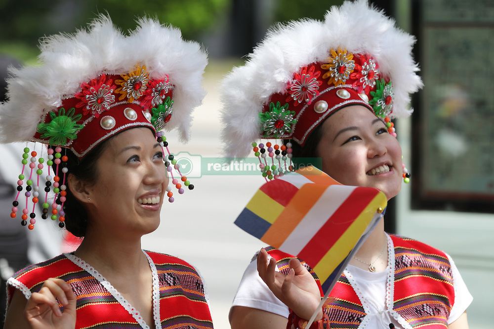 May 28, 2017 - Mississauga, Ontario, Canada - Singaporean Buddhist girls dressed in traditional attire during the festival of Vesak in Mississauga, Ontario, Canada on 28 May 2017. Vesak (Wesak) commonly known as Lord Buddha's birthday celebration marks the birth, enlightenment and death of Lord Buddha. (Credit Image: © Creative Touch Imaging Ltd/NurPhoto via ZUMA Press)