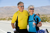 Senior couple in sportswear on roadside