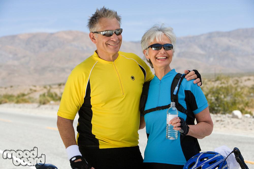 Senior couple in sportswear on roadside