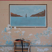 A painting on a wall in the closed down refugee camp at the Port of Lakki. <br />