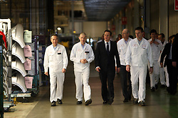 File photo dated 10/02/11 of former prime minister David Cameron (centre) visiting the Honda plant in Swindon. Honda is planning to close the plant in three years time, according to unconfirmed reports.
