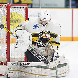 "TRENTON, ON  - MAY 3,  2017: Canadian Junior Hockey League, Central Canadian Jr. ""A"" Championship. The Dudley Hewitt Cup. Game 3 between the Powassan Voodoos and the Dryden GM Ice Dogs.  Nate McDonald #33 of the Powassan Voodoos makes the save during the first period <br /> (Photo by Amy Deroche / OJHL Images)"