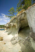 Sandstone caves and sculptures naturally formed through erosion can be found throughout the Gulf Islands, this particular beach can be found on Galiano Island.  Gulf Islands, British Columbia, Canada