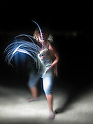 Painting with light. woman outlined with light Affect produced with light source and long exposure