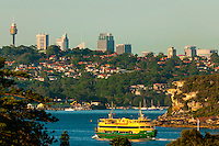 A ferry boat en route from Circular Quay in Sydney to Manly, (with Sydney's Central Business District in the background), Sydney, New South Wales, Australia