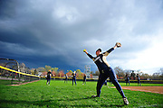 Severe weather rolls in as Emily Durham, of Lemont, warms up after a lightening delay at T.F. South, Tuesday, April 29th, 2014 in Lansing.