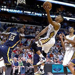 Oct 30, 2013; New Orleans, LA, USA; New Orleans Pelicans shooting guard Eric Gordon (10) shoots over Indiana Pacers center Roy Hibbert (55) during the fourth quarter of a game at New Orleans Arena. The Pacers defeated the Pelicans 95-90. Mandatory Credit: Derick E. Hingle-USA TODAY Sports