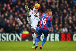 Kolo Toure of Liverpool kicks the ball high under pressure from Dwight Gayle of Crystal Palace - Mandatory byline: Jason Brown/JMP - 07966386802 - 06/03/2016 - FOOTBALL - London - Selhurst Park - Crystal Palace v Liverpool - Barclays Premier League