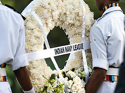 © Licensed to London News Pictures. 11/11/2012. Delhi, India. Members of the Indian Navy carry a wreath to a memorial at Remembrance Day ceremony held at the Delhi War Cemetery, India. Remembrance Day (also known as Poppy Day or Armistice Day) is a memorial day observed in Commonwealth countries since the end of World War I to remember the members of their armed forces who have died in the line of duty. This day, or alternative dates, are also recognized as special days for war remembrances in many non-Commonwealth countries. Remembrance Day is observed on 11 November to recall the end of hostilities of World War I on that date in 1918.   Photo credit : Richard Isaac/LNP