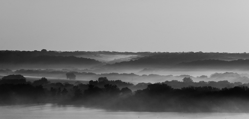 Fog lays in the lowlands of the bluffs lining the Illinois River near Peoria, Illinois.