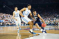 04 APR 2016: Guard Phil Booth (5) of Villanova University drives the lane against Forward Kennedy Meeks (3) of the University of North Carolina during the 2016 NCAA Men's Division I Basketball Final Four Championship game held at NRG Stadium in Houston, TX. Villanova defeated North Carolina 77-74 to win the national title. Brett Wilhelm/NCAA Photos