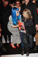 PARIS, FRANCE - MARCH 08:  Katy Perry poses with a Fan after the Jean-Charles de Castelbajac Ready to Wear Autumn/Winter 2011/2012 show during Paris Fashion Week at Pavillon Concorde on March 8, 2011 in Paris, France.  (Photo by Tony Barson/WireImage)
