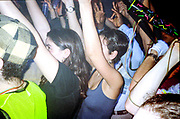 Crowd vibing with arms up, Dream FM Pirate Radio Benefit, Labyrinth Dalston, London, 1994