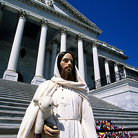 Jesus Christ Statue on the steps of The United States Capitol Building with the World Flags, Washington DC, USA