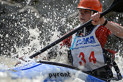 "Garrett Bentley of St. Louis, Mo. races in the K1 Men's Novice/Expert class on the slalom course of the 45th Annual Missouri Whitewater Championships. Bentley placed third in the class and second in the downriver K1 Men's Plastic (under 30 class). The Missouri Whitewater Championships, held on the St. Francis River at the Millstream Gardens Conservation Area, is the oldest regional whitewater slalom race in the United States. Heavy rain in the days prior to the competition sent water levels on the St. Francis River to some of the highest heights that the race has ever been run. Only expert classes were run on the flood level race course.Novices who chose to race were re-classified as ""novice experts"" to recognize their achievements."