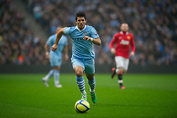 MANCHESTER, ENGLAND - Sunday, January 8, 2012: Manchester City's Sergio Aguero in action against Manchester United during the FA Cup 3rd Round match at the City of Manchester Stadium. (Pic by David Rawcliffe/Propaganda)