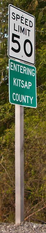 scene along a cross country trip with in a classic Mini Cooper auto - entering Kitsap County road sign