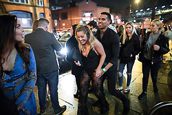 """© Licensed to London News Pictures . 17/12/2016 . Manchester , UK . A couple smile as they pass along Deansgate Locks . Revellers out in Manchester City Centre overnight during """" Mad Friday """" , named for being one of the busiest nights of the year for the emergency services in the UK . Photo credit : Joel Goodman/LNP"""