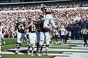 STARKVILLE, MS - SEPTEMBER 19:  Gabe Myles #35 of the Mississippi State Bulldogs is lifted by teammates after scoring a touchdown against the Northwestern State Demons at Davis Wade Stadium on September 19, 2015 in Starkville, Mississippi.  The Bulldogs defeated the Demons 62-13.  (Photo by Wesley Hitt/Getty Images) *** Local Caption *** Gabe Myles