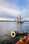 Lady Washington at sail in Semiahmoo Bay, Washington. A historic replica of the original 18th Century brig. Owned and operated by the Grays Harbor Historical Seaport, Aberdeen, Washington. 3 pound gun swivel mounted gun on the Hawaiian Chieftain is in the foreground.