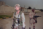 US Army Col. Jesse Johnson directs special forces operations at the U.S. Embassy in Kuwait City as special operation commandos retake the building during the liberation of Kuwait City as Sergeant Major Joe Dennison provides security February 26, 1991 in Kuwait City, Kuwait.