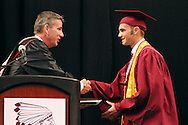 Principal Scott Butler (left) presents the valedictorian plaque to Alex Barsala during the 142nd annual Lebanon High School commencement at the Nutter Center in Fairborn, Saturday, May 26, 2012.