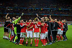 LILLE, FRANCE - Friday, July 1, 2016: Wales players celebrate a 3-1 victory over Belgium and reaching the Semi-Final during the UEFA Euro 2016 Championship Quarter-Final match at the Stade Pierre Mauroy. (Pic by David Rawcliffe/Propaganda)