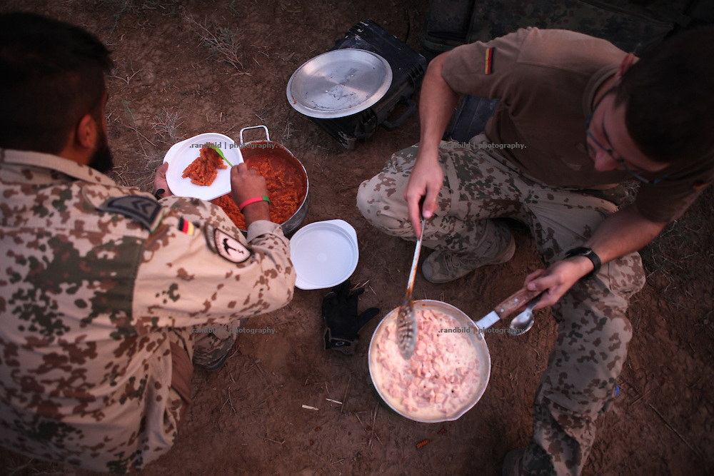 Soldiers cook as best as possible by mixing ready-to-eat meals. In late October 2011 Kunduz based 3.Task Force started a several days operation in and around Nawabad (District Chahar Darah), west of Kunduz, northern Afghanistan. During the Operation Orpheus about 100 german infantery soldiers rolled out for patrols through the town and surrounding areas, which were expected as a retreat zone of insurgents.