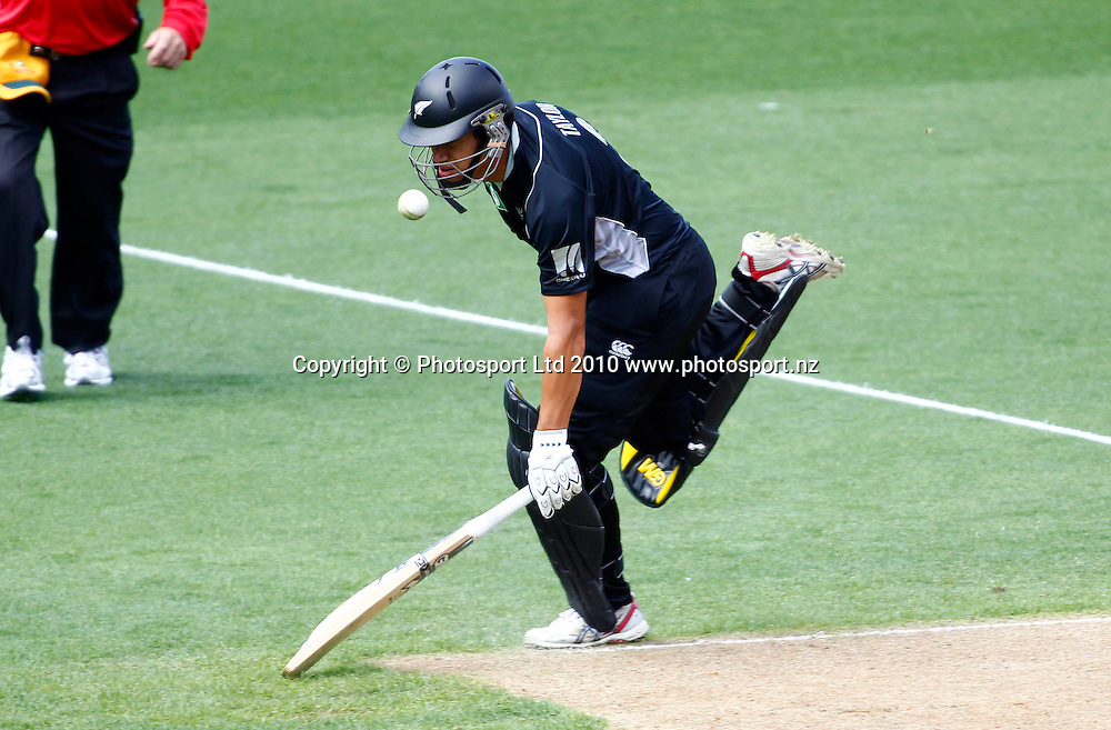Blackcaps batsman Ross Taylor is hit by the ball as he slides his bat to make ground. 4th one day international. New Zealand Black Caps versus Australia one day Chappell Hadlee cricket series. Eden Park, Auckland, New Zealand. Thursday 11 March 2010. Photo: Simon Watts/PHOTOSPORT