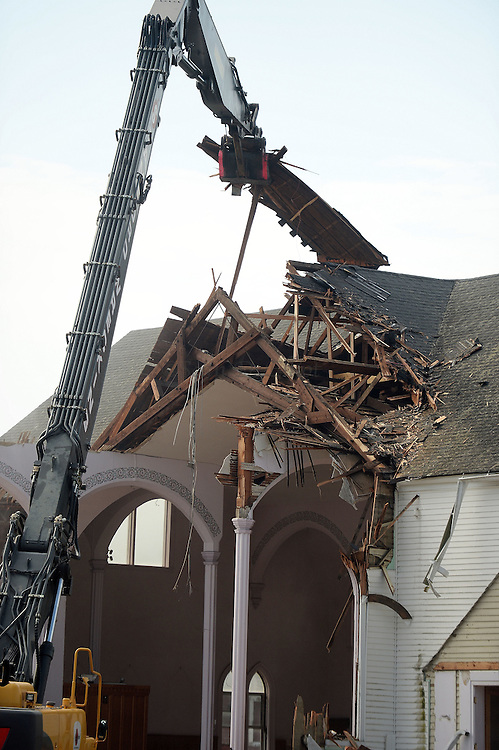 7/25/16 :: REGION :: STAND ALONE :: Workers from Stamford Wrecking tear-down St. Michael The Archangel Roman Catholic Church on Liberty St. in Pawcatuck Monday, July 25, 2016. The church has been closed since April of 2012 when structural problems were found. The new church will be built on the original foundation. (Sean D. Elliot/The Day)