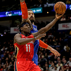 Dec 12, 2018; New Orleans, LA, USA; New Orleans Pelicans guard Jrue Holiday (11) shoots over Oklahoma City Thunder center Steven Adams (12) during the second half at the Smoothie King Center. Mandatory Credit: Derick E. Hingle-USA TODAY Sports