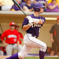 Apr 04, 2010; Baton Rouge, LA, USA; LSU Tigers out fielder Trey Watkins (3) with a single against the Georgia Bulldogs during a game at Alex Box Stadium. Mandatory Credit: Derick E. Hingle-US PRESSWIRE