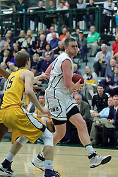 21 February 2017:  Trevor Seibring works against Jacob Johnston during an College men's division 3 CCIW basketball game between the Augustana Vikings and the Illinois Wesleyan Titans in Shirk Center, Bloomington IL
