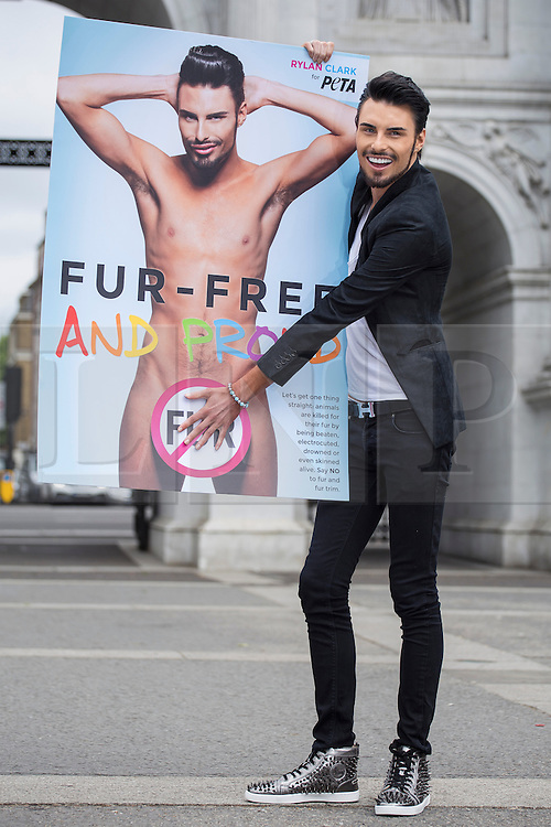 """© licensed to London News Pictures. London, UK 12/06/2013. X Factor finalist and Celebrity Big Brother star Rylan Clark revealing the new PETA Anti-Fur advert in a photocall in Marble Arch, London. The advert has """"No Fur"""" logo with his naked picture as part of PETA's 'Let's Get One Thing Straight: Say No to Fur' campaign. Photo credit: Tolga Akmen/LNP"""