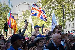 "© Licensed to London News Pictures . 06/05/2018. London, UK. Crowd at the demonstration outside Downing Street on Whitehall . Supporters of alt-right and anti-Islam groups, including Generation Identity and the Democratic Football Lads Alliance, demonstrate at Whitehall in Westminster, opposed by anti-fascists. Speakers billed in the ""Day for Freedom"" include former EDL leader Tommy Robinson, Milo Yiannopoulos, youtuber Count Dankula (Markus Meechan), For Britain leader Anne Marie Waters, UKIP leader Gerard Batten, Breitbart's Raheem Kassam and Lauren Southern. The event was originally planned as a march to Twitter's HQ in protest at their banning of Robinson and the Home Office's ban on Martin Sellner and Brittany Pettibone entering the UK, in what protesters describe as limits being imposed on free speech. Photo credit: Joel Goodman/LNP"